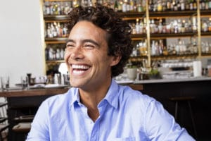 Man smiling using Invisalign