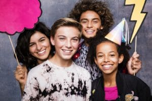 Teens smiling for Invisalign ad